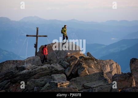Climber at the summit of the Ahornspitze, Zillertal Alps, Tirol, Austria. - Stock Photo
