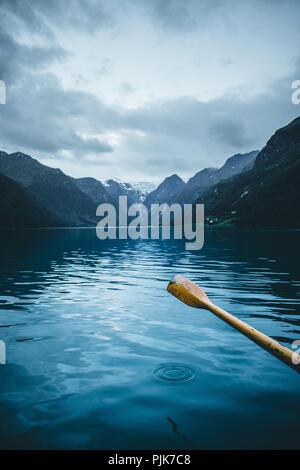 Norway, Stryn, Jostedalsbreen Glacier, Briksdalsbreen, oar of a rowing boat - Stock Photo