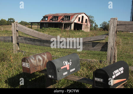 Mailboxes by farm with abandoned barn in Virginia's countryside. - Stock Photo