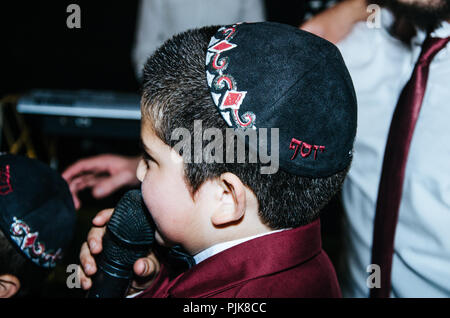 Back child wearing a Kippah at a wedding - Stock Photo
