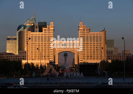 Astana, Kazakhstan, August 3 2018: Complex of buildings on the National Corporation KazMunaiGas during sunset at Nurzhol Bulvar - Stock Photo