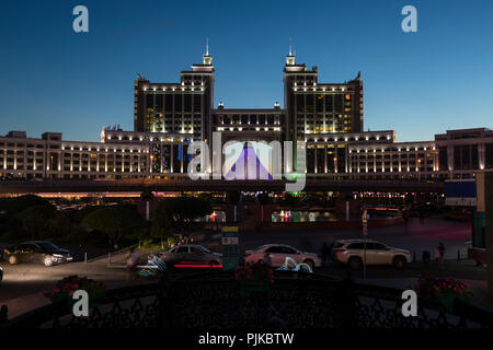 Astana, Kazakhstan, August 3 2018: Complex of buildings on the National Corporation KazMunaiGas during night at Nurzhol Bulvar - Stock Photo