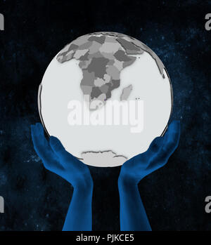 Swaziland with flag on globe in hands in space. 3D illustration. - Stock Photo