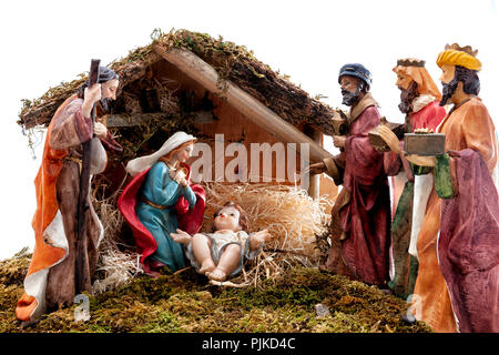 Christmas nativity scene. Hut with baby Jesus in the manger, with Mary, Joseph and the three wise men. Isolated on white background. - Stock Photo