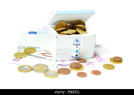 Holiday cash, Euro coins and notes in and under a wooden box - Stock Photo
