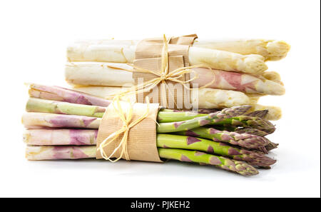 Green and white asparagus tied in front of white background - Stock Photo