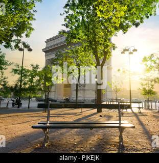Arc de Triomphe in Paris at the sunset - Stock Photo
