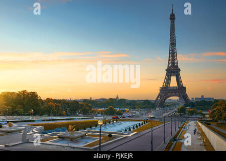 Eiffel Tower and fountains near it at dawn in Paris, France - Stock Photo