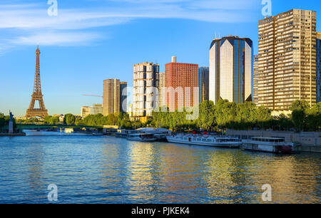 Modern district of skyscrapers on Seine with view on Eiffel Tower in Paris, France - Stock Photo