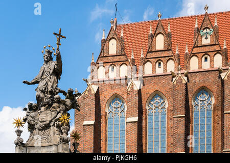 Poland, Wroclaw, baroque column with statue of Saint John of Nepomuk, Church of the Holy Cross - Stock Photo