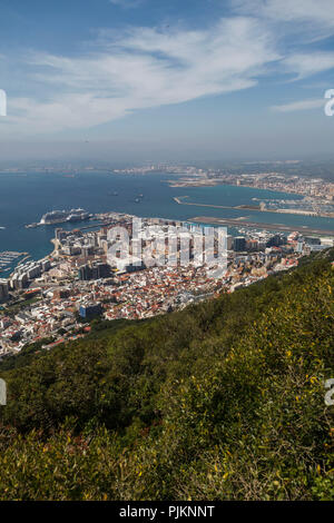 View from the Rock to Gibraltar, gem and British enclave at the Mediterranean Sea and La Línea de la Concepción, border town on the Spanish mainland - Stock Photo
