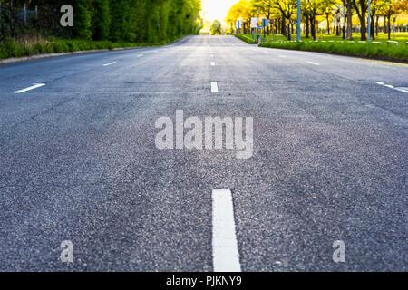 A four-lane road leading to the horizon, - Stock Photo