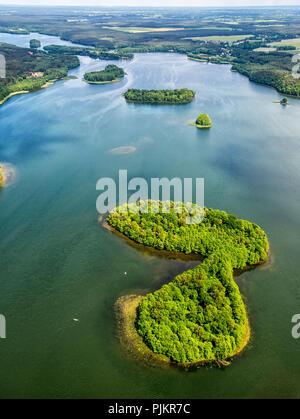 Lakeland landscape, Pomerania, reflection, wooded island, Lenice, Baltic Sea coast, Pomorskie, Poland - Stock Photo