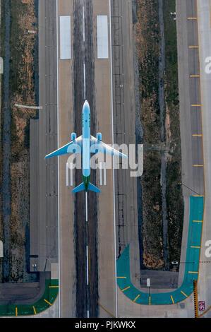 LAX, Los Angeles International Airport, Runway, Jet taking off, Los Angeles, Los Angeles County, California, USA - Stock Photo