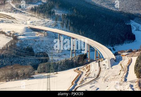 Expansion of the A46 motorway bridge Nuttlar in the snow, highest bridge in the state of NRW, Olsberg, Sauerland, North Rhine-Westphalia, Germany - Stock Photo