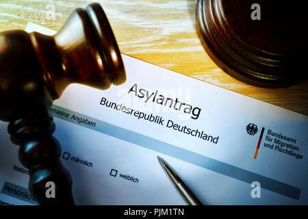 Application for asylum, judge's gavel, asylum procedure - Stock Photo
