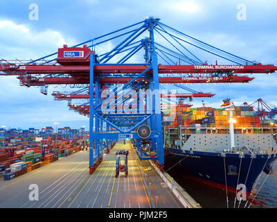 Loading of containers at the container terminal Burchardkai - Stock Photo