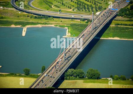 Motorway bridge blocked for truck traffic, ramshackle motorway bridge over Rhine at Leverkusen -West, Pylons, Rhine crossing A1, traffic infrastructure, roads, Cologne, Rhineland, North Rhine-Westphalia, Germany - Stock Photo