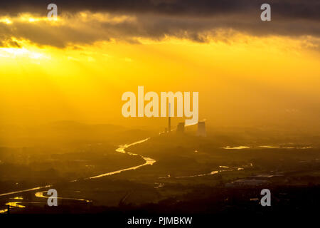 STEAG coal power plant Bergkamen on the Datteln-Hamm Canal in the evening light, smog, haze, hazy weather, inversion weather, back light, golden light, industrial romance, sun shining through cloud hole on the power plant, Bergkamen, Ruhr area, North Rhine-Westphalia, Germany - Stock Photo