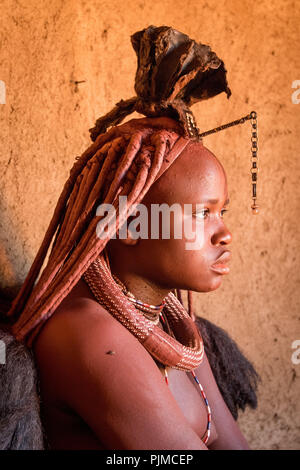 Portrait of a Himba woman with traditional headgear, side profile