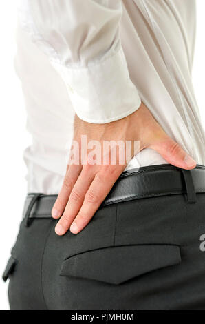 Detail of businessman with back pain. - Stock Photo