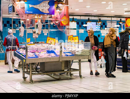 MADRID, SPAIN - 26 MARCH, 2018: Large food supermarket with customers and products and staff. - Stock Photo