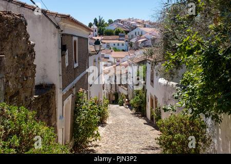 View down a narrow cobblestone street in the Jewish district of Castelo de Vide, Alentejo, Portugal - Stock Photo