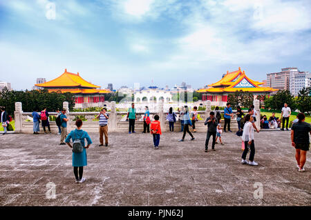 march 31, 2018.  Taipei, Taiwan. Tourists in front of the Chiang Kai-Shek Memorial with the national concert  and theater halls in the background in t - Stock Photo