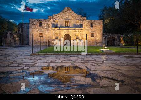 The Alamo is an old Spanish mission (like a church built by Catholic missionaries to minister to the natives) that is in what is now San Antonio, Texa - Stock Photo
