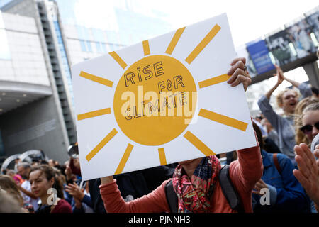 Brussels, Belgium. 8th Sep. 2018.Activists hold placards and chant slogans during a demonstration to demand immediate an action on climate change in front of European Parliament. Alexandros Michailidis/Alamy Live News - Stock Photo