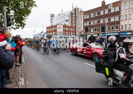 West Bridgford, Nottingham, UK 8th September 2018. Spectators watch and photograph as the Tour of Britain cycle race passes over Trent Bridge in West Bridgford, Nottingham.  Credit: Martyn Williams/Alamy Live News - Stock Photo