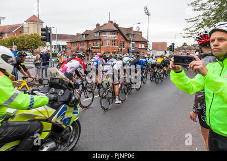West Bridgford, Nottingham, UK. 8th September 2018. Spectators watch and photograph as the Tour of Britain cycle race passes over Trent Bridge in West Bridgford, Nottingham.  Credit: Martyn Williams/Alamy Live News - Stock Photo