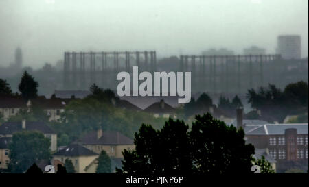 Glasgow, Scotland, UK. 8th September, 2018. UK Weather: Rain and mist cause limited visibility over the city as the west of Glasgow disappears behind the kelvindale gasometers and the rooftops of the suburb of knightswood . Gerard Ferry/Alamy news - Stock Photo