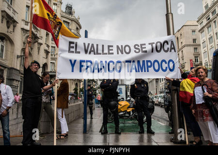 Madrid, Spain. 8th September, 2018. People protesting in front of Congress of Deputies with a banner that reads 'Don't touch the Valley and neither Franco' during a protest against the removal of dictator Franco's remains from the Valley of the Fallen, in Madrid, Spain. Credit: Marcos del Mazo/Alamy Live News - Stock Photo