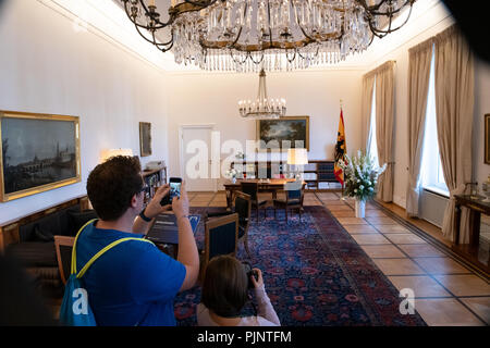 Berlin, Germany. 08th Sep, 2018. A visitor to the citizens' festival at Bellevue Castle takes a photo of President Steinmeier's office. Credit: Paul Zinken/dpa/Alamy Live News - Stock Photo