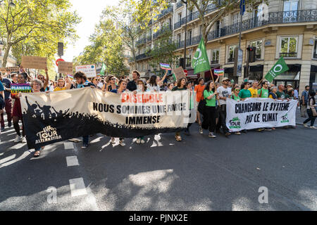 Paris, France. 8 September 2018. People marching against climate change holding signs. © David Bertho / Alamy Live News - Stock Photo