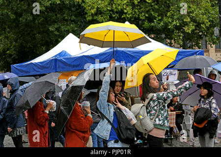 Manchester, UK. 8th Sept, 2018. Friends pose for a selfie under umbrellas at the Manchester Passport to Taiwan Festival, the largest Taiwanese festival in the UK, which brings Taiwanese food and music, to the city, Albert Square, Manchester , 8th September, 2018 (C)Barbara Cook/Alamy Live News - Stock Photo