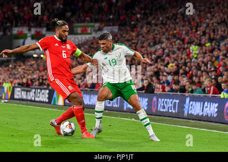 Cardiff, Cardiff, UK. 1st July, 2018. Ashley Williams (Captain) & Jon Walters seen in action during the game.UEFA Nations League match between Wales and Republic of Ireland at Cardiff City Stadium. Wales beat Ireland 4:1. Credit: Ben Ryan/SOPA Images/ZUMA Wire/Alamy Live News - Stock Photo