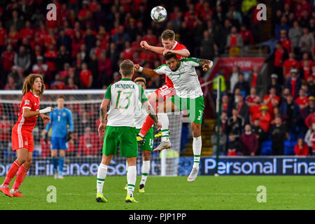 Cardiff, Cardiff, UK. 1st July, 2018. Aaron Ramsey & Cyrus Christie seen in action during the game.UEFA Nations League match between Wales and Republic of Ireland at Cardiff City Stadium. Wales beat Ireland 4:1. Credit: Ben Ryan/SOPA Images/ZUMA Wire/Alamy Live News - Stock Photo
