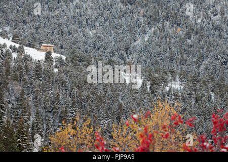 Refuge of Pla de la Font surrounded by snow-covered trees in winter. Pyrenees. Catalonia. Spain. - Stock Photo