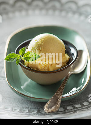 Homemade Organic Vanilla Ice Cream scoop in cup - Stock Photo