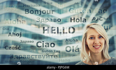 Student girl portrait and word hello translated in different languages on modern background. Young school teacher learning and speaking many languages - Stock Photo