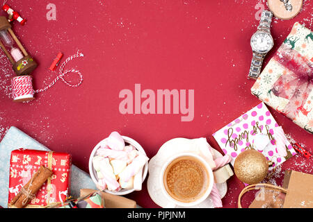 A cup of fragrant coffee and New Year decor on a red background. gifts and syootrizy for Christmas. Top view. Frame. Copy space - Stock Photo