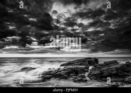 Sunset over the beach at Tresaith in Ceredigion, Wales. Colour version at PJPM12. - Stock Photo