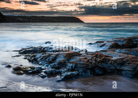 Sunset over the beach at Tresaith in Ceredigion, Wales, looking towards Aberporth. - Stock Photo