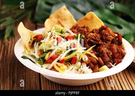 Nasi Campur Bali. Popular Balinese meal of rice with meat. Typical Malaysian street food lunch mixed rice - Stock Photo