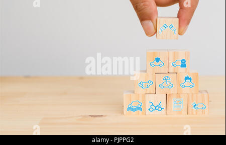 insurance concept, hand man try to put the insurance to protect or cover car, auto, flood, earthquake, fire, explosion, lighting, theft, vandalism, bo - Stock Photo