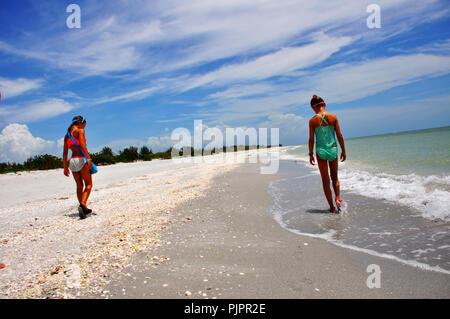 Shelling on Sanibel Island - Stock Photo