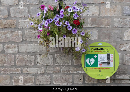 Defibrillator on the outside wall of the Black Lion Pub in Firbeck Village near Worksop - Stock Photo