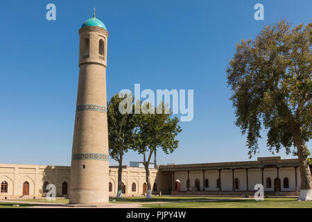 The architectural ensemble of the Jami (Friday) Mosque includes the minaret in the middle of the garden in Kokand. - Stock Photo